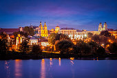 Evening view of Minsk cityscape with Holy Spirit Cathedral over Svisloch River, Belarus