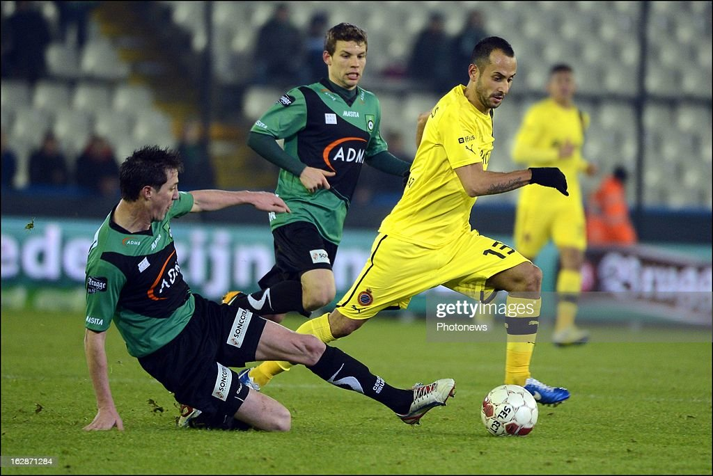 Evens Bernt of Cercle Brugge competes for the ball with Victor Vazquez (R) of Club Brugge KV during the Jupiler League match between Cercle Brugge and Club Brugge on February 28, 2013 in Brugge, Belgium.