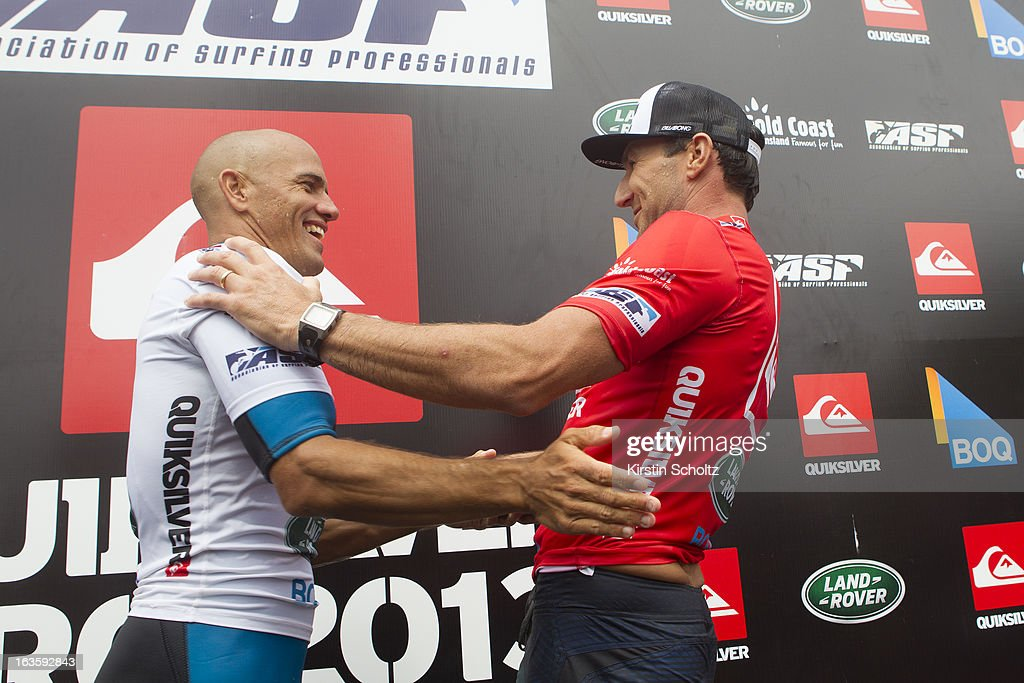 Event champion <a gi-track='captionPersonalityLinkClicked' href=/galleries/search?phrase=Kelly+Slater&family=editorial&specificpeople=207101 ng-click='$event.stopPropagation()'>Kelly Slater</a> of the United States of America and runner up <a gi-track='captionPersonalityLinkClicked' href=/galleries/search?phrase=Joel+Parkinson&family=editorial&specificpeople=234875 ng-click='$event.stopPropagation()'>Joel Parkinson</a> congratulate one another during prizegiving during the Quiksilver Pro on March 13, 2013 in Gold Coast, Australia.