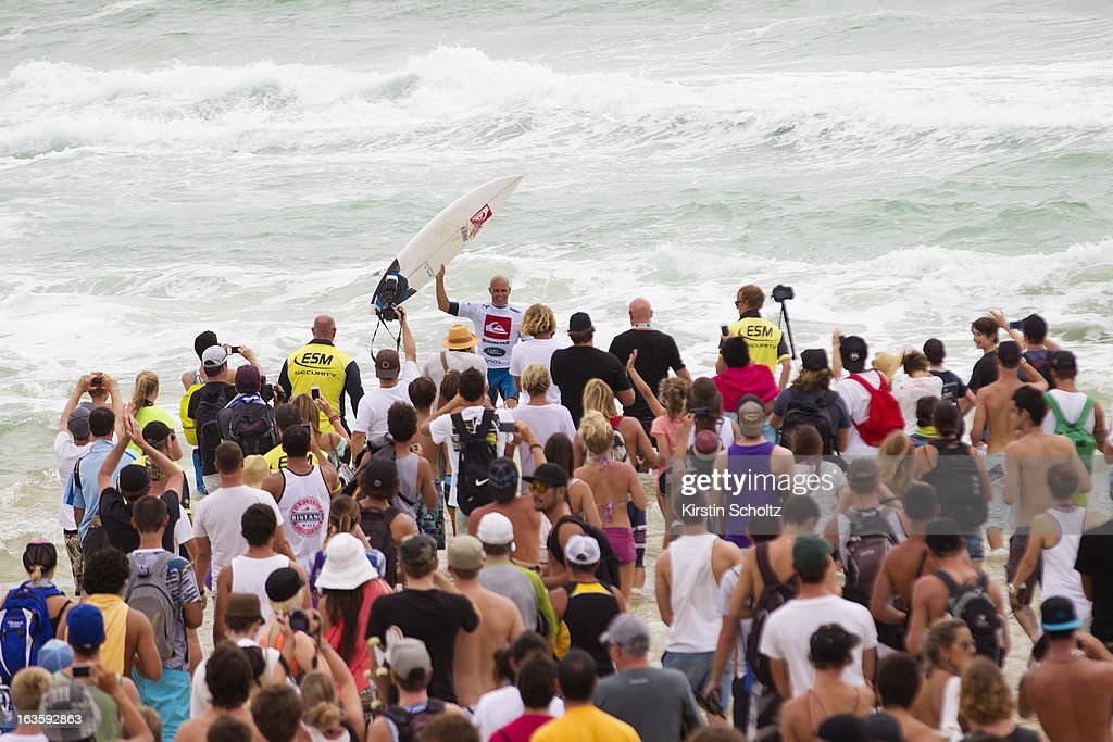 Event champion <a gi-track='captionPersonalityLinkClicked' href=/galleries/search?phrase=Kelly+Slater&family=editorial&specificpeople=207101 ng-click='$event.stopPropagation()'>Kelly Slater</a> of the United States of America is greeted by the crowd after winning the final against Joel Parkinson during the Quiksilver Pro on March 13, 2013 in Gold Coast, Australia.