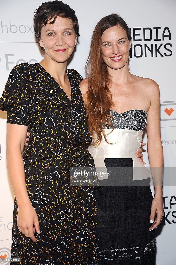 Event Co-Chair <a gi-track='captionPersonalityLinkClicked' href=/galleries/search?phrase=Maggie+Gyllenhaal&family=editorial&specificpeople=202607 ng-click='$event.stopPropagation()'>Maggie Gyllenhaal</a> (L) and Founder and Executive Director of The Lunchbox Fund Topaz Page-Green attend the Lunchbox Fund Fall Fete 2013 at Buddakan on October 9, 2013 in New York City.