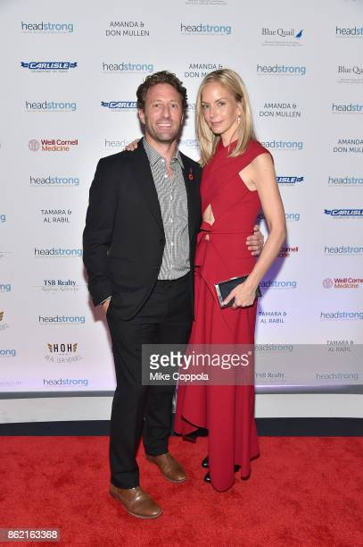 Event cochair Marine veteran Founder of Headstrong Zach Iscol and Event cochair and former senior editor of Vogue Meredith Melling attend the...