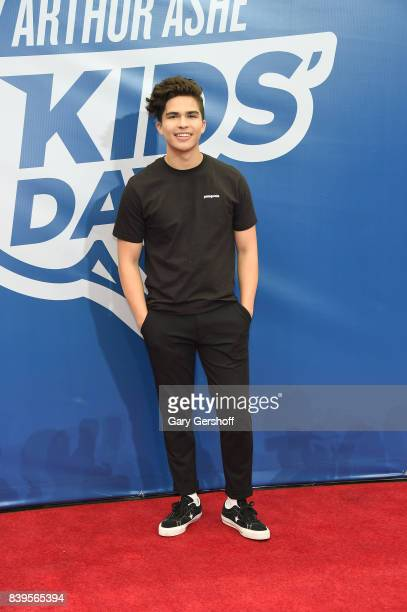 Event cohost singer Alex Aiono attends the 22nd Annual Arthur Ashe Kids' Day event at USTA Billie Jean King National Tennis Center on August 26 2017...