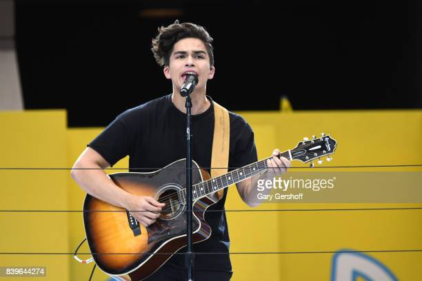 Event cohost singer Alex Aiono performs on stage during the 22nd Annual Arthu Ashe Kids' Day event at USTA Billie Jean King National Tennis Center on...