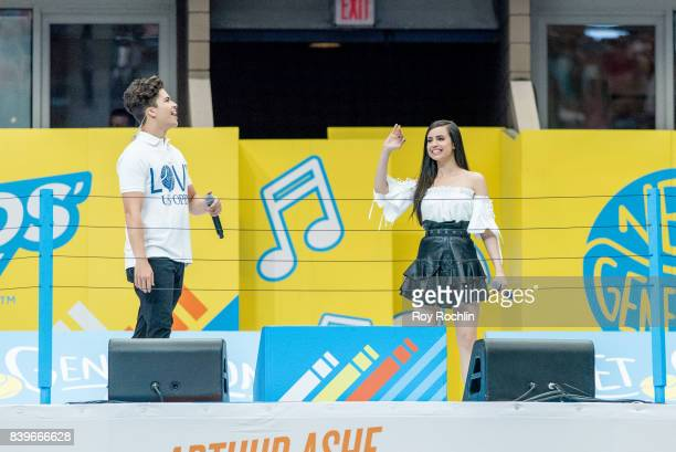 Event cohosts singers Alex Aiono and Sofia Carson perform on stage during the 22nd Annual Arthur Ashe Kids' Day at USTA Billie Jean King National...