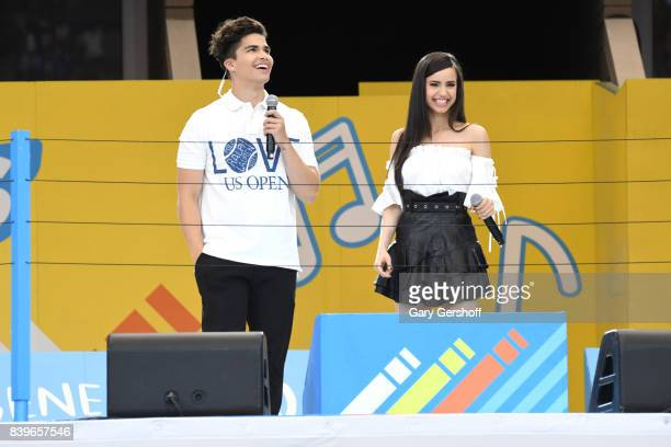Event cohosts singers Alex Aiono and Sofia Carson seen on stage during the 22nd Annual Arthur Ashe Kids' Day event at USTA Billie Jean King National...