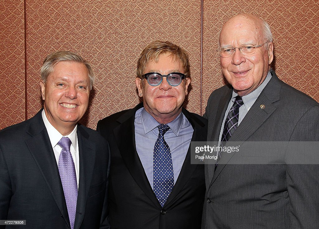 Event co-hosts U.S. Senators Lindsay Graham (L) (R-SC) and Patrick Leahey (D-VT) pose for a photo with Sir <a gi-track='captionPersonalityLinkClicked' href=/galleries/search?phrase=Elton+John&family=editorial&specificpeople=171369 ng-click='$event.stopPropagation()'>Elton John</a>, Founder, <a gi-track='captionPersonalityLinkClicked' href=/galleries/search?phrase=Elton+John&family=editorial&specificpeople=171369 ng-click='$event.stopPropagation()'>Elton John</a> AIDS Foundation, before an <a gi-track='captionPersonalityLinkClicked' href=/galleries/search?phrase=Elton+John&family=editorial&specificpeople=171369 ng-click='$event.stopPropagation()'>Elton John</a> AIDS Foundation and The ONE Campaign hosted reception on global HIV/AIDS funding at the U.S. Capitol Visitor Center on May 5, 2015 in Washington, DC.