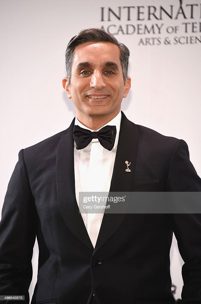 Event host, <a gi-track='captionPersonalityLinkClicked' href=/galleries/search?phrase=Bassem+Youssef&family=editorial&specificpeople=9660617 ng-click='$event.stopPropagation()'>Bassem Youssef</a> poses for pictures during the 43rd International Emmy Awards press room reception on November 23, 2015 in New York City.