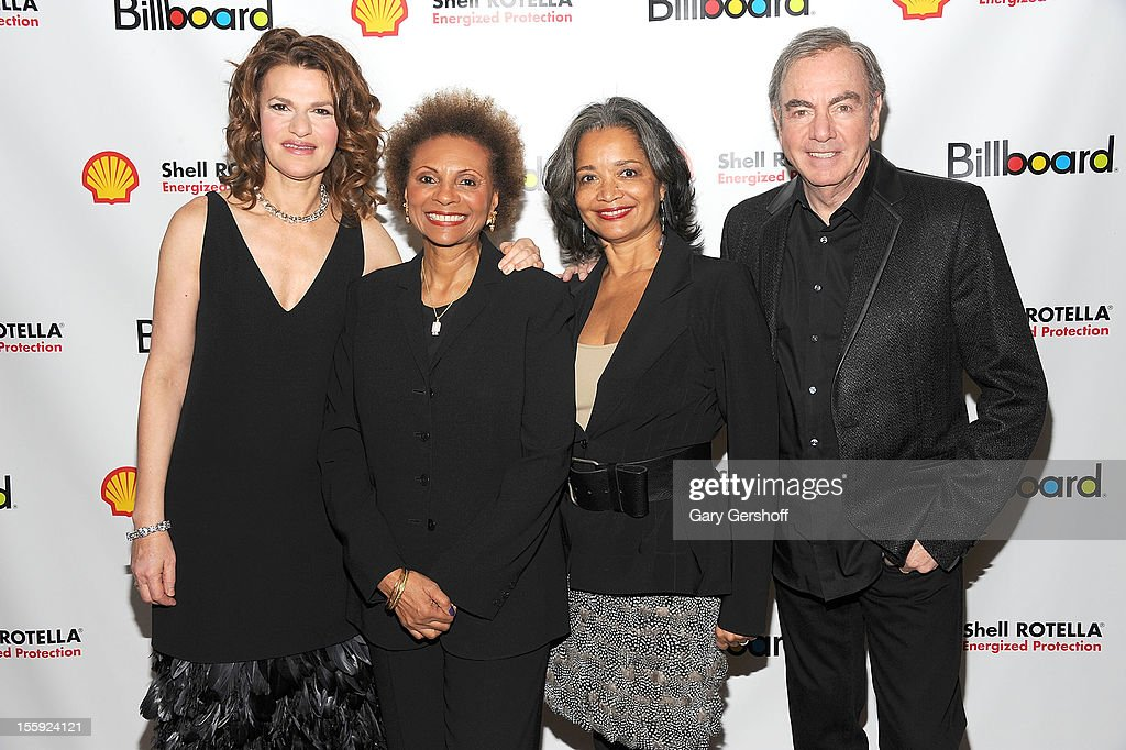 Event host <a gi-track='captionPersonalityLinkClicked' href=/galleries/search?phrase=Sandra+Bernhard&family=editorial&specificpeople=204693 ng-click='$event.stopPropagation()'>Sandra Bernhard</a>, <a gi-track='captionPersonalityLinkClicked' href=/galleries/search?phrase=Leslie+Uggams&family=editorial&specificpeople=213729 ng-click='$event.stopPropagation()'>Leslie Uggams</a>, President and Chief Executive Officer, The Apollo, Jonelle Procope, and <a gi-track='captionPersonalityLinkClicked' href=/galleries/search?phrase=Neil+Diamond&family=editorial&specificpeople=210635 ng-click='$event.stopPropagation()'>Neil Diamond</a> attend the 2012 Billboard Touring Awards Reception at The Roosevelt Hotel on November 8, 2012 in New York City.