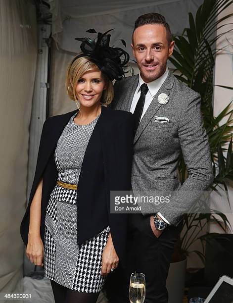 Event MC's Donny Galella and Sophie Falkiner pose inside the Fashions on the Field enclosure during the BMW Australian Derby at Royal Randwick...