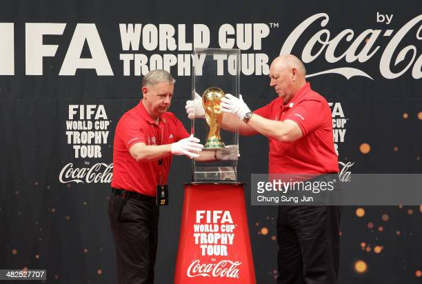 Event members carry the FIFA World Cup Trophy during the event of presentation as part of the FIFA World Cup Trophy that has now arrived to South...