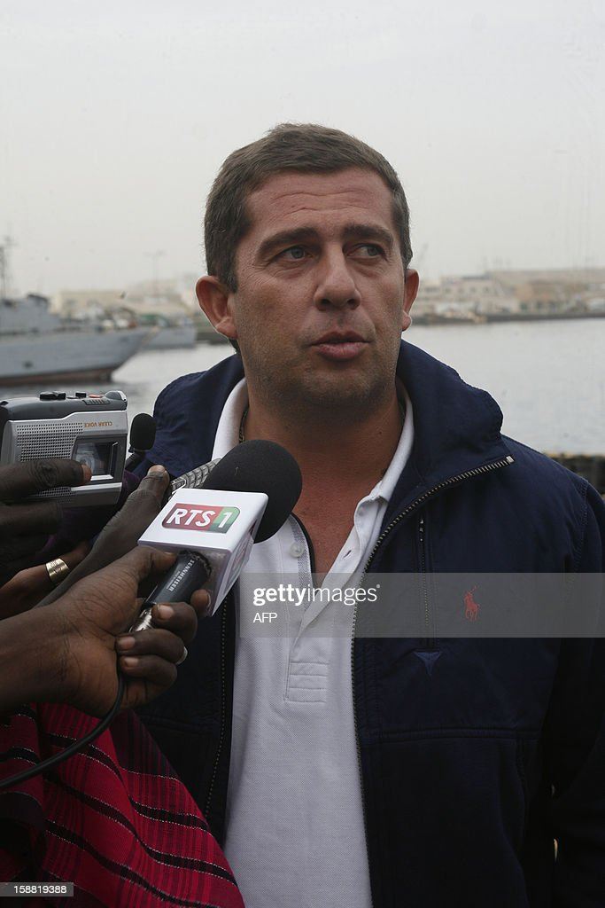 Event organiser Felipe Matos, working for a Portuguese pyrotechnic company, answers journalists next to fireworks waiting to be moved offshore and to be lit on New Year's Eve, on December 30, 2012 in the port of Dakar. Senegal's capital will organize the 'biggest fireworks' of its history and plans on using six tons of pyrotechnical material, operated by Portuguese pyrotechnists.