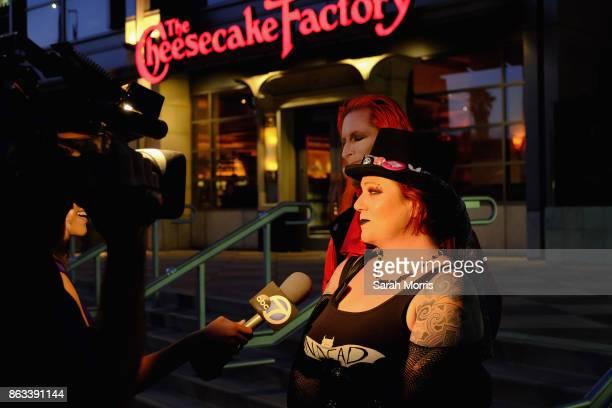 Event organizer Mary Soracco is interviewed at the Tom Petty Memorial Vampire Walk down Ventura Blvd on October 19 2017 in Sherman Oaks California