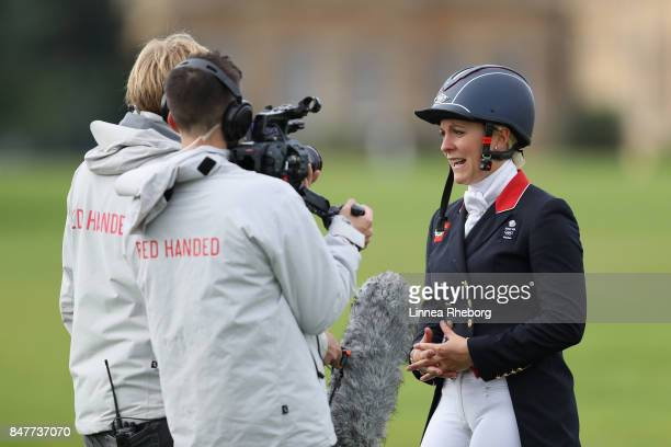 Event rider Gemma Tattersall of Great Britain gets interviewed after her ride in the dressage discipline of Event Riders Masters during day two of...