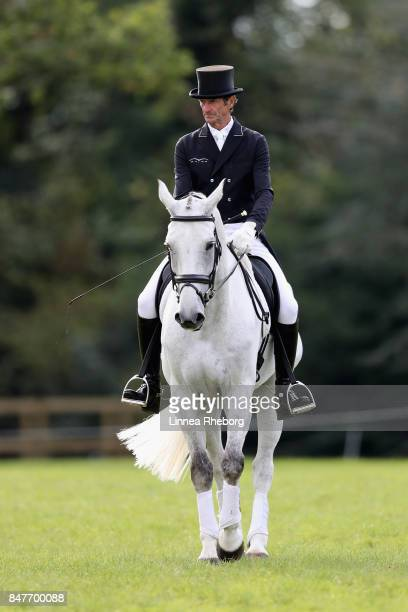 Event rider Sir Mark Todd of New Zealand riding Kiltubrid Rhapsody during a warm up prior to the dressage discipline of Event Riders Masters during...