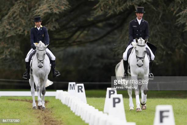 Event rider Tim Price of New Zealand riding Ascona M and Sir Mark Todd of New Zealand riding Kiltubrid Rhapsody during a warm up prior to the...