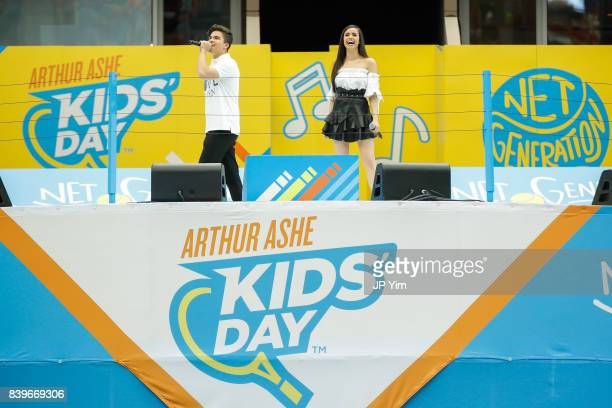 Events cohosts and singers Alex Aiono and Sofia Carson speak onstage at the 22nd Annual Arthur Ashe Kid's Day event at the USTA Billie Jean King...