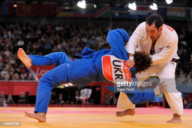 Eventual Bronze A medallist NyamOchir Sainjargal of Mongolia scores with a foot sweep against Volodymyr Soroka of Ukraine during the 73 kg Judo on...
