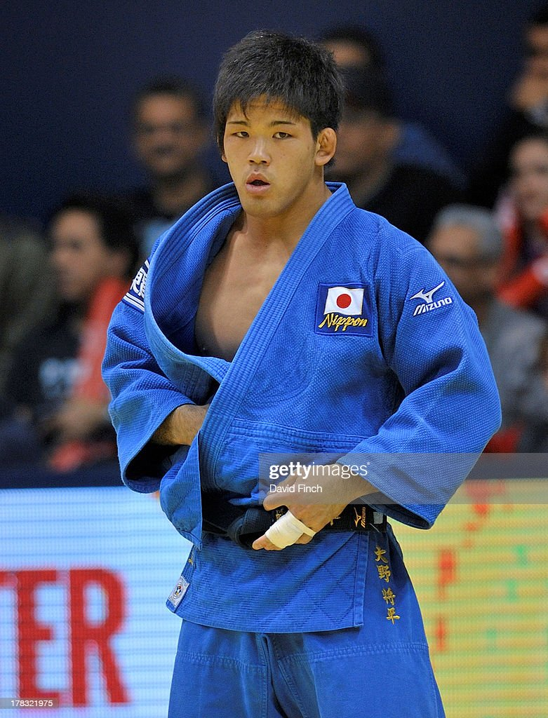 Eventual champion, Shohei Ono of Japan, adjusts his judogi (judo suit) just after throwing Dirk van Tichelt of Belgium for ippon (10 points) to win their u73kgs contest on day 3 of the Rio World Judo Championships, on August 28, 2013 at the Gympasium Maracanazinho, Rio de Janeiro, Brazil.