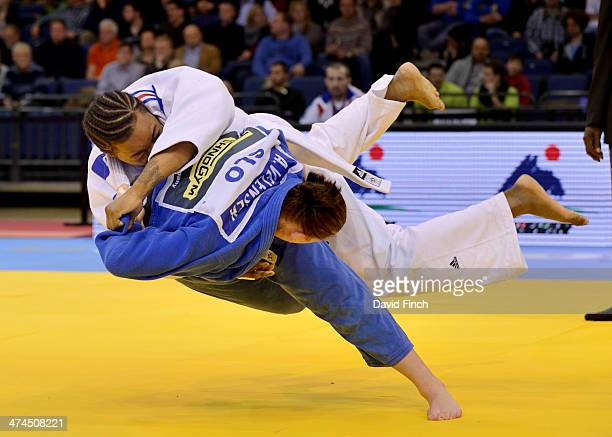 Eventual silver medallist Anamari Velensek of Slovenia throws Audrey Tcheumeo of France for ippon to reach the u78kg final where she won the silver...