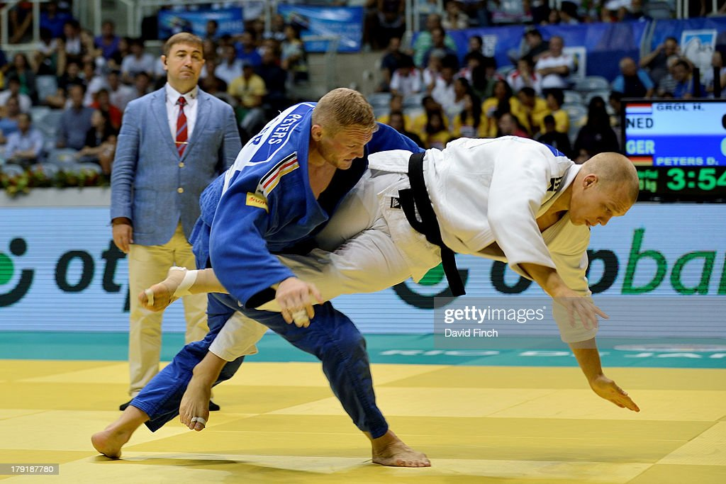 Eventual silver medallist, Henk Groll of Holland (white) twists out of this scoreless attack by <a gi-track='captionPersonalityLinkClicked' href=/galleries/search?phrase=Dimitri+Peters&family=editorial&specificpeople=875495 ng-click='$event.stopPropagation()'>Dimitri Peters</a> of Germany in the u100kgs quarter-finals during the Rio World Judo Championships on Day 6 at the Gympasium Maracanazinho on August 31, 2013 in Rio de Janeiro, Brazil.