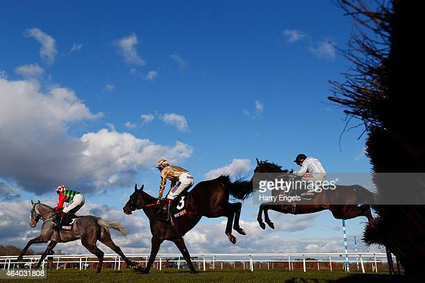 Eventual winner Barry Geraghty riding Days of Heaven jumps a hurdle during The Sky Bet Dovecote Novices' Hurdle Race at Kempton Park racecourse on...