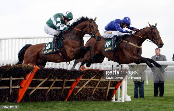 Eventual winner Forest Pennant ridden by Ruby Walsh jumps the last with Superior Wisdom ridden by William Kennedy in the John Smith's Extra Cold...