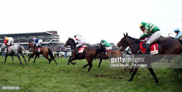 Eventual winner Garde Champetre ridden by Miss Nina Carberry jumps a fence on her way to victory in the Glenfarclas Cross Country Handicap Steeple...