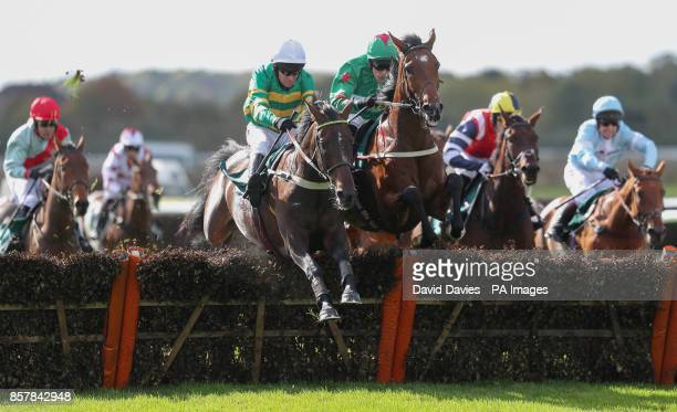Eventual winner Herewego Herewego ridden by Barry Geraghty jumps the last with Megabucks ridden by James Davies in the Old Fourpenny Shop 'National...