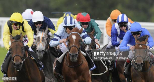 Eventual winner Holberg and Joe Fanning sit in the middle of the pack turning for home before winning The Queens Vase during day four of The Royal...