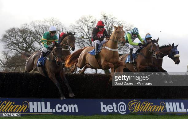 Eventual winner Made in Time ridden by Will Kennedy jumps with Master Fiddle ridden by Barry Geraghty and Rangitoto ridden by Ruby Walsh and Vino...