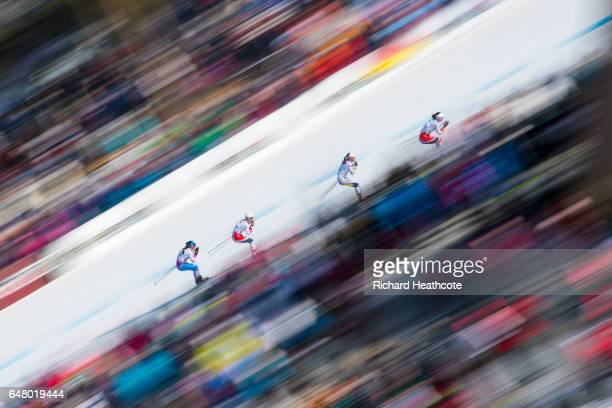 Eventual winner Marit Bjoergen of Norway leads Charlotte Kalla of Sweden Heidi Weng of Norway and Krista Parmakoski of Finland during the Women's...