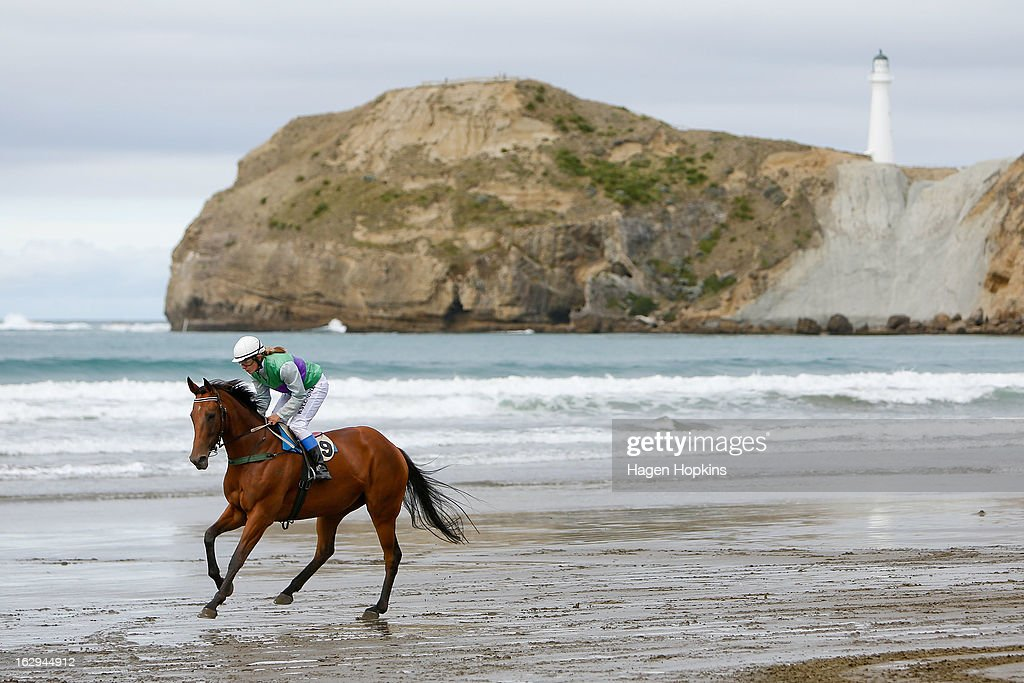 Eventual winner, The Rose, makes its way down to the start of the Castlepoint Cup Open during the Castlepoint Beach Races at Castlepoint Beach on March 2, 2013 in Masterton, New Zealand.