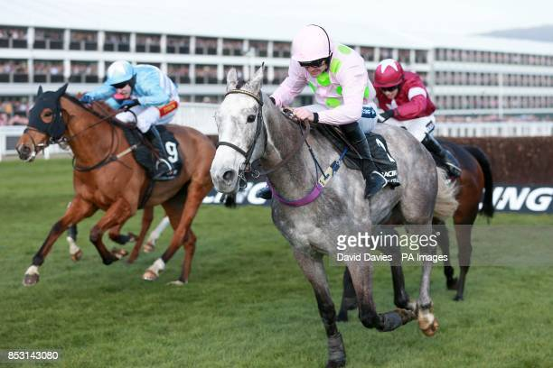 Eventual winner Western Warhorse ridden by Tom Scudamore gets up to beat early front runner Champagne Fever ridden by Ruby Walsh who finished second...