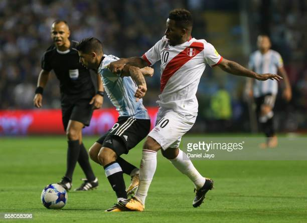 Ever Banega of Argentina and Jefferson Farfan of Peru fight for the ball during a match between Argentina and Peru as part of FIFA 2018 World Cup...