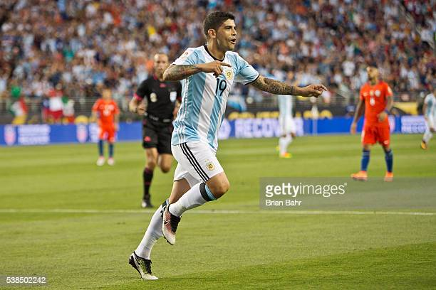 Ever Banega of Argentina celebrates after scoring the second goal against Chile in the second half during a group D match between Argentina and Chile...