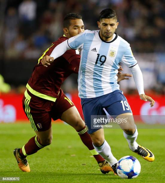 Ever Banega of Argentina fights for the ball with Yangel Herrera of Venezuela during a match between Argentina and Venezuela as part of FIFA 2018...