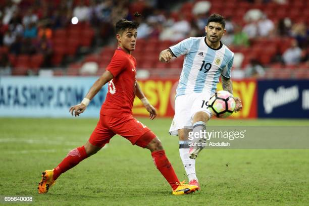 Ever Banega of Argentina makes a pass during the International Test match between Argentina and Singapore at National Stadium on June 13 2017 in...