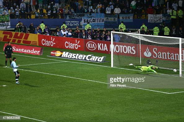 Ever Banega of Argentina takes the third penalty kick in the penalty shootout during the 2015 Copa America Chile quarter final match between...