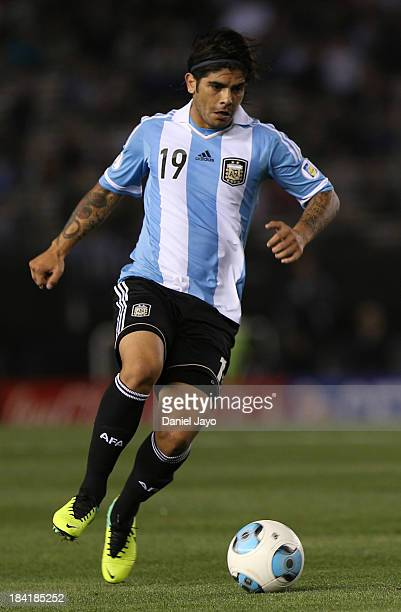 Ever Banega of Argetntina conducts the ball between Argentina and Peru as part of the 17th round of the South American Qualifiers at Antonio Vespucio...