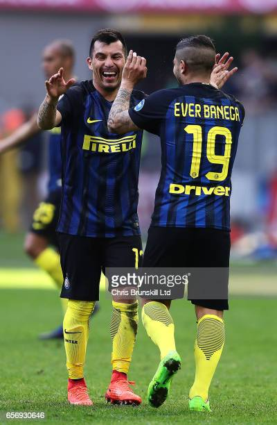 Ever Banega of FC Internazionale celebrates scoring his side's fourth goal with teammate Gary Medel during the Serie A match between FC...