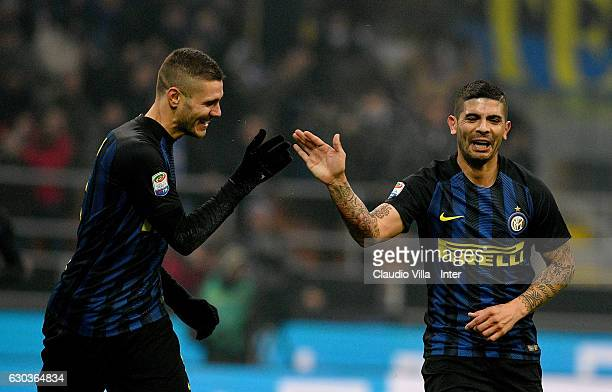 Ever Banega of FC Internazionale celebrates with Mauro Icardi of FC Internazionale after scoring the opening goal during the Serie A match between FC...