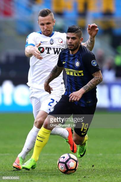 Ever Banega of FC Internazionale in action with Jasmin Kurtic of Atalanta BC during the Serie A match between FC Internazionale and Atalanta BC at...