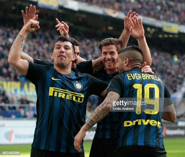 Ever Banega of FC Internazionale Milano celebrates his first goal with his teammate Gary Alexis Medel and Cristian Ansaldi during the Serie A match...