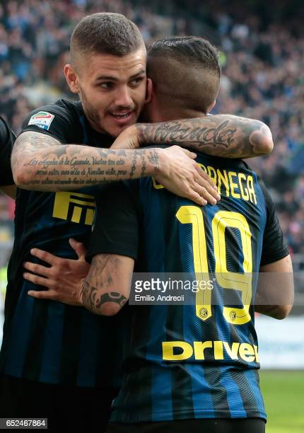 Ever Banega of FC Internazionale Milano celebrates his first goal with his teammate Mauro Emanuel Icardi during the Serie A match between FC...