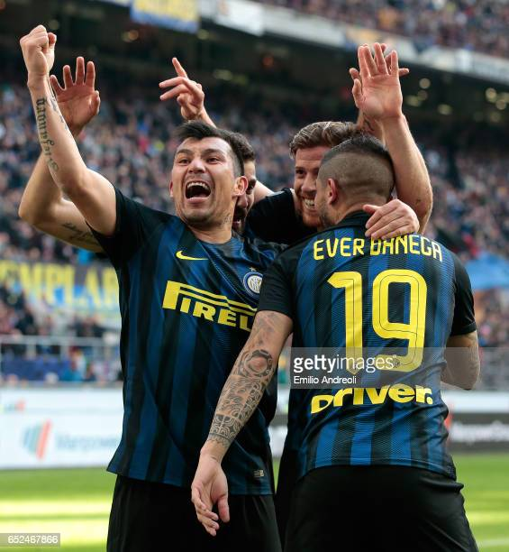 Ever Banega of FC Internazionale Milano celebrates his first goal with his teammate Gary Alexis Medel during the Serie A match between FC...
