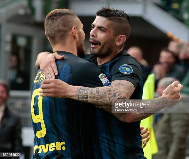 Ever Banega of FC Internazionale Milano celebrates his second goal with his teammate Mauro Emanuel Icardi during the Serie A match between FC...
