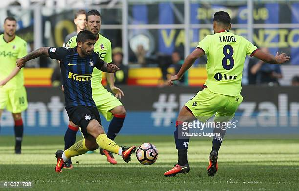 Ever Banega of Inter competes for the ball with Saphir Taider of Bologna during the Serie A match between FC Internazionale and Bologna FC at Stadio...