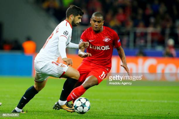 Ever Banega of Sevilla and Fernando of Spartak Moscow in action during the UEFA Champions League match between Spartak Moscow and Sevilla FC at...