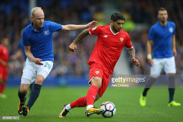 Ever Banega of Sevilla beats Davy Klaassen of Everton during a preseason friendly match between Everton and Sevilla at Goodison Park on August 6 2017...